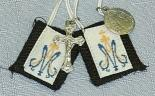CHILDREN'S BROWN SCAPULAR with white cord.